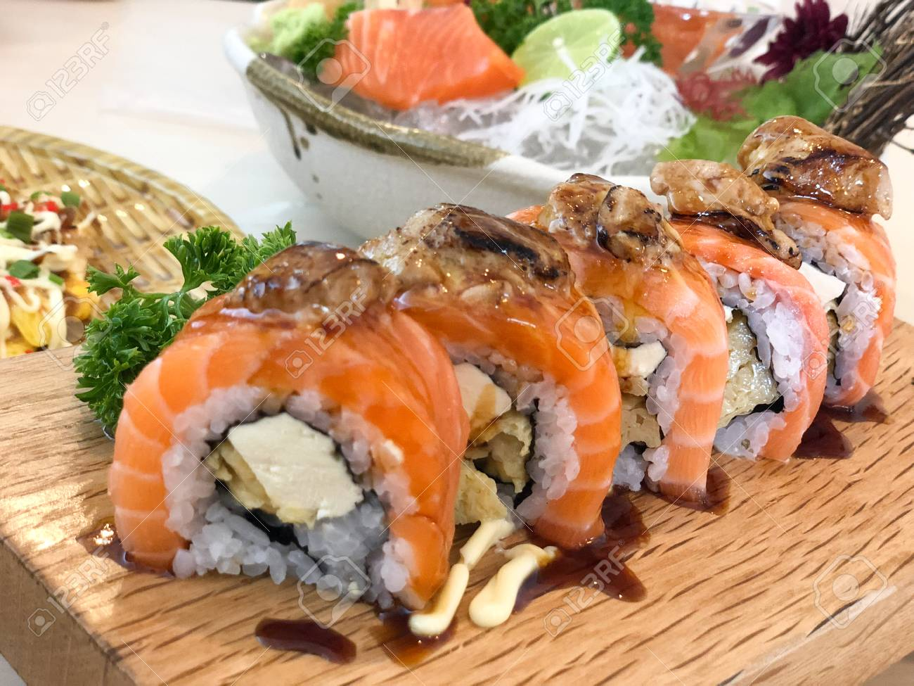 Closeup Grill Salmon Roll Sushi On Wood Dish In The Restaurant Stock Photo Picture And Royalty Free Image Image 96901797