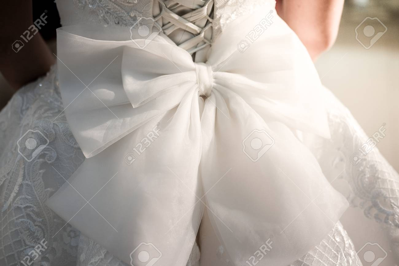 Close Up Image Of The Detailed Laces On The Back Of A Wedding Dress