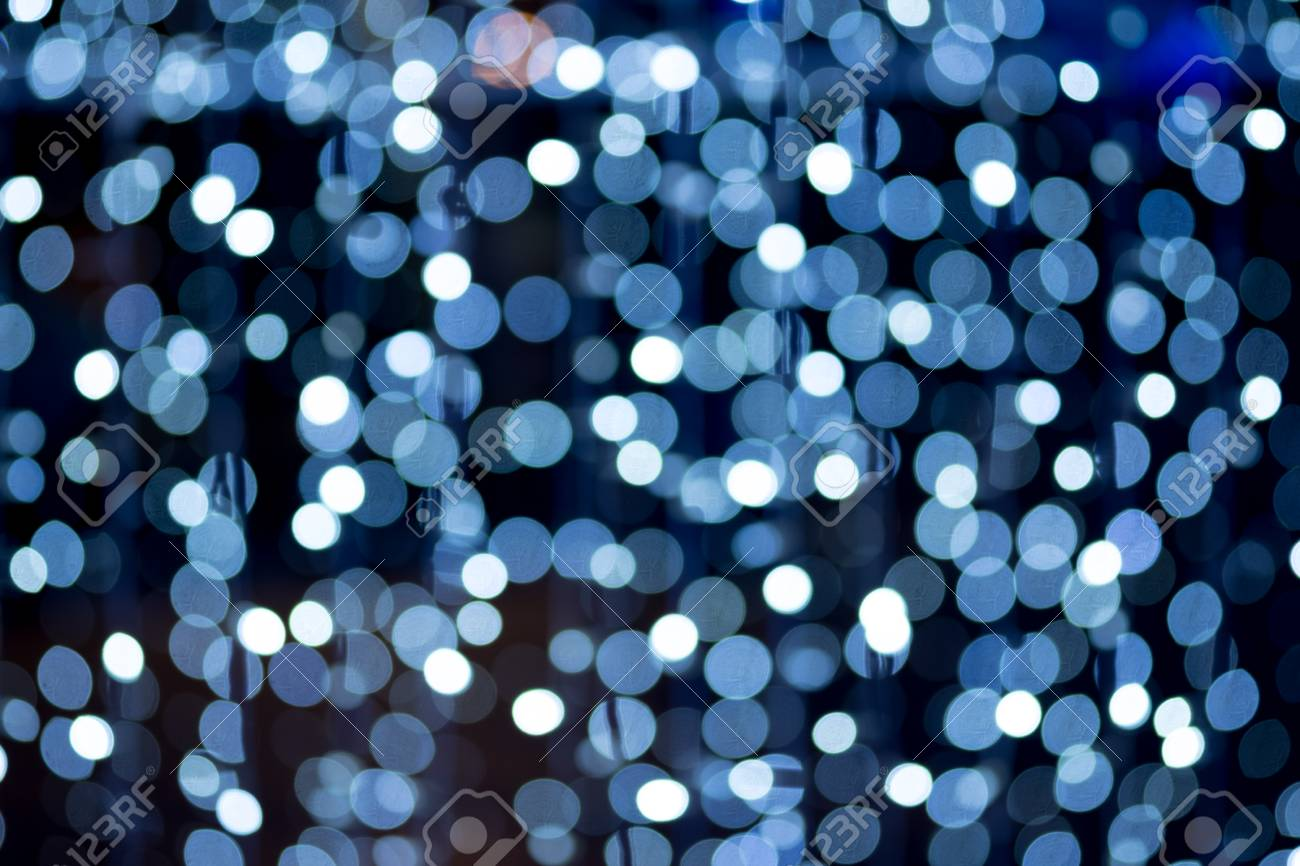 White And Blue Lights Over Dark Blue Background Blur Background