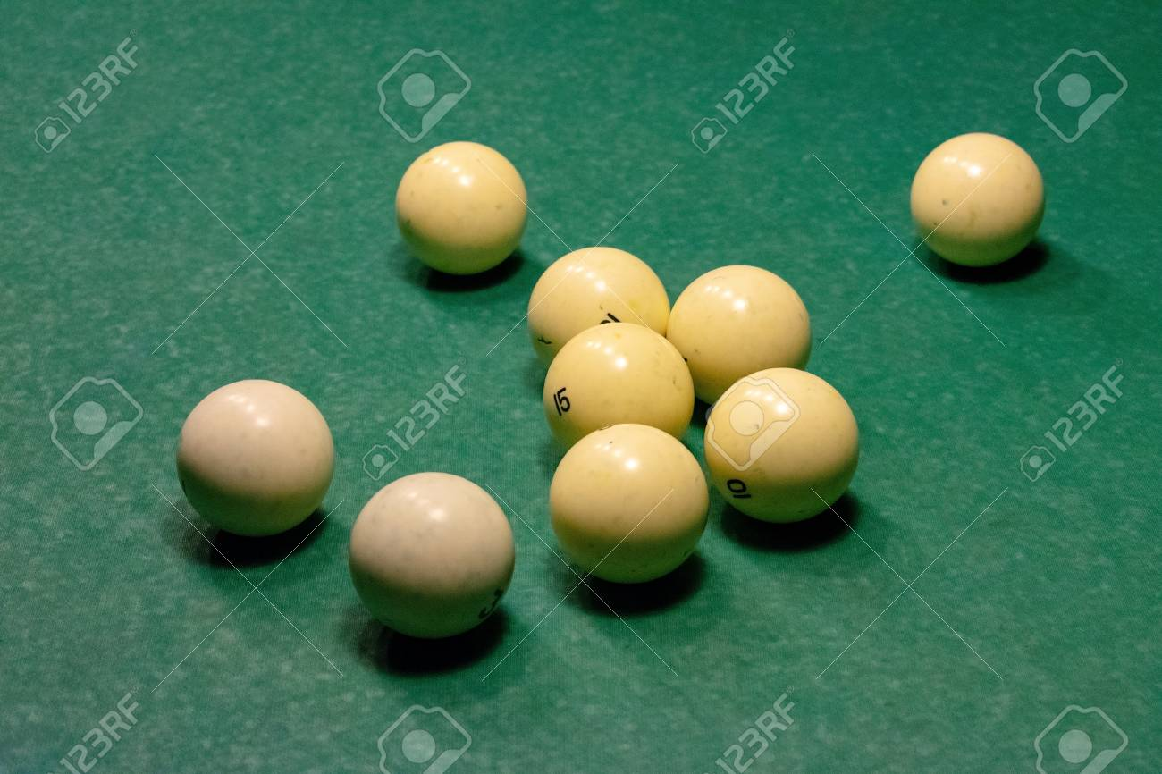 Ivory White Billiard Balls On A Green Pool Table. Stock Photo   113436739