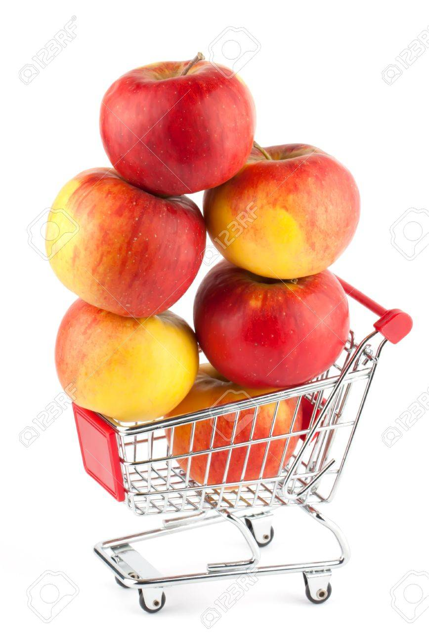 Buying healthy food. Shopping trolley with apples on white Stock Photo - 11794516