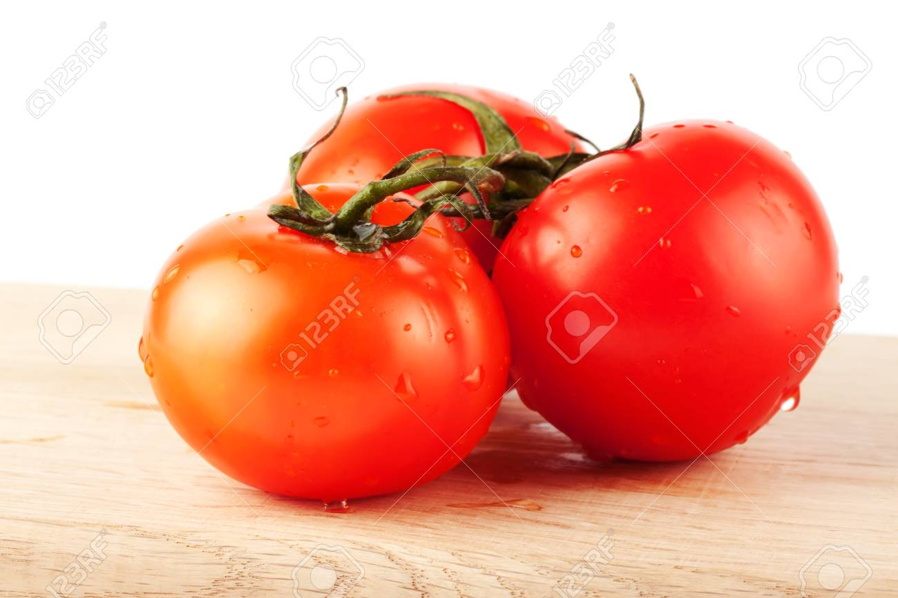 Stack of perfect red tomatos extreme closeup Stock Photo - 11930727