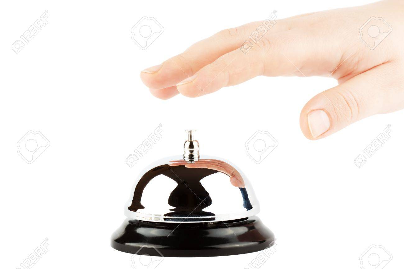 Ringing a Bell for Service with Hand on the white background Stock Photo - 12043347