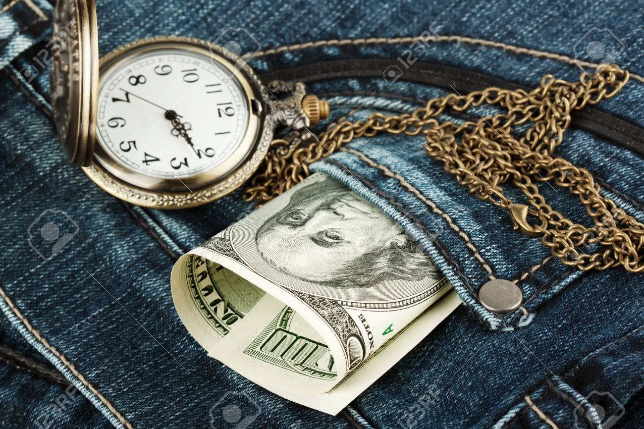 Closeup Money and watch in a jeans pocket Stock Photo - 12460257