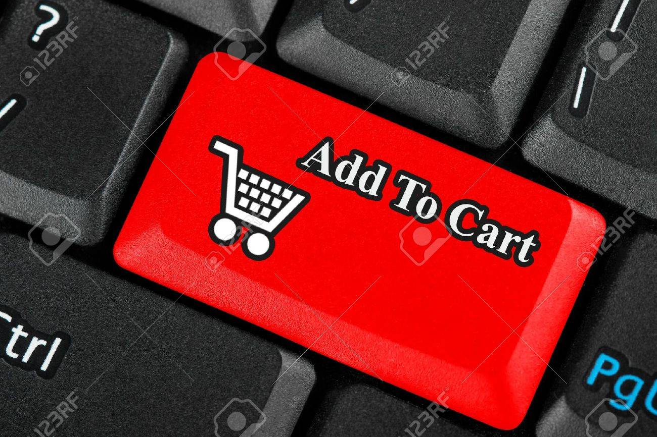 Red retail shopping cart icon button on a keyboard Stock Photo - 12460828