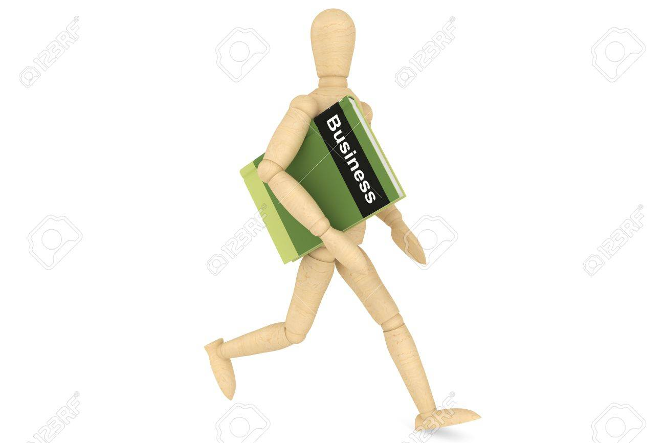Wooden Dummy with book on a white background Stock Photo - 15396570