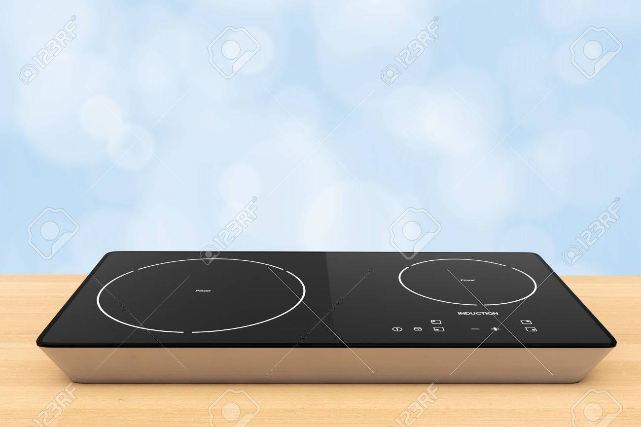 Mobile Portable Induction Cooktop Stove On A Wooden Table 3d Rendering  Stock Photo