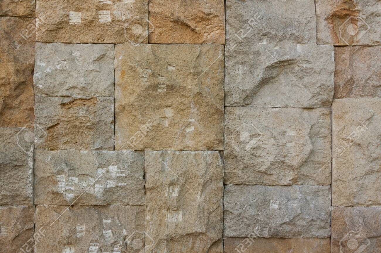 Chipped Stone Wall Background extreme closeup - 123709715