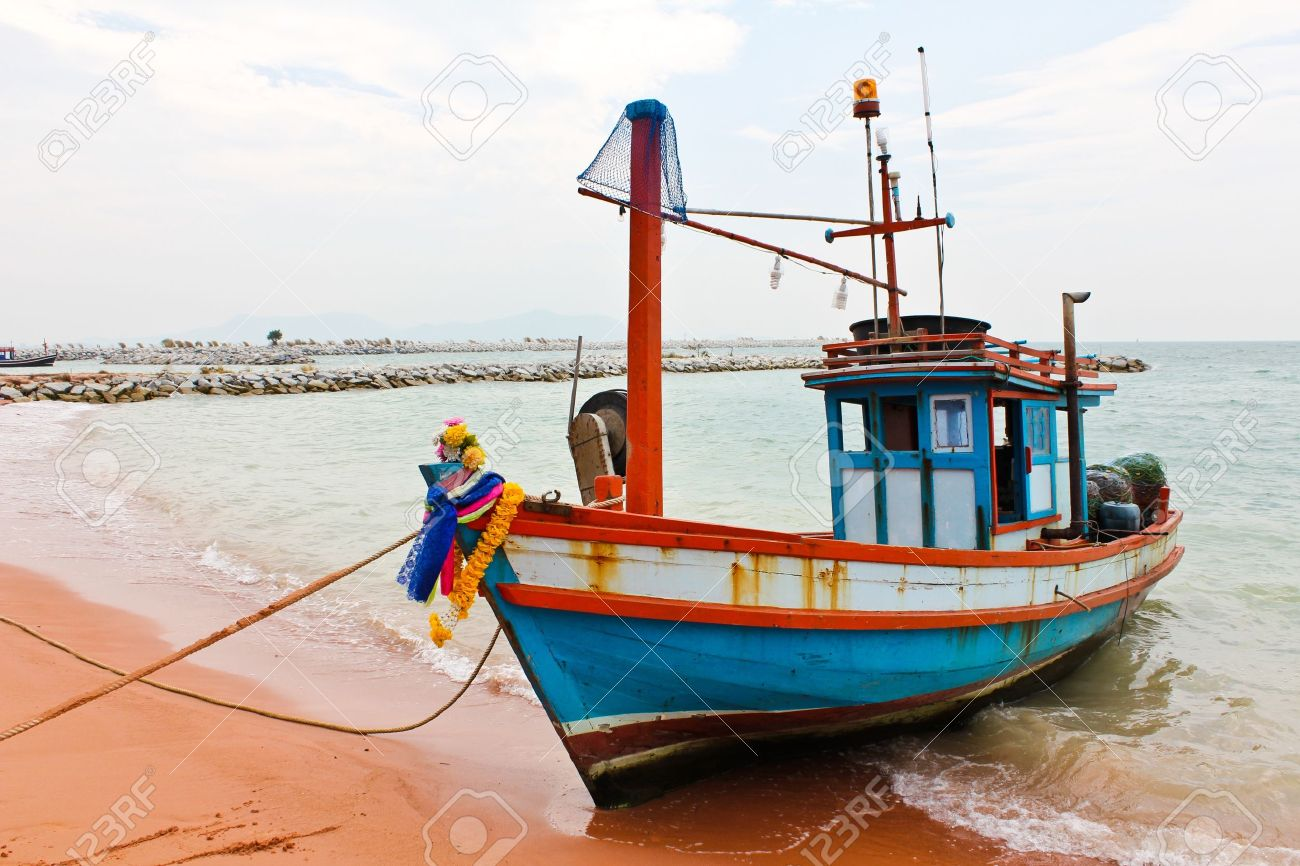 wooden fishing boat on the beach stock photo picture and royalty