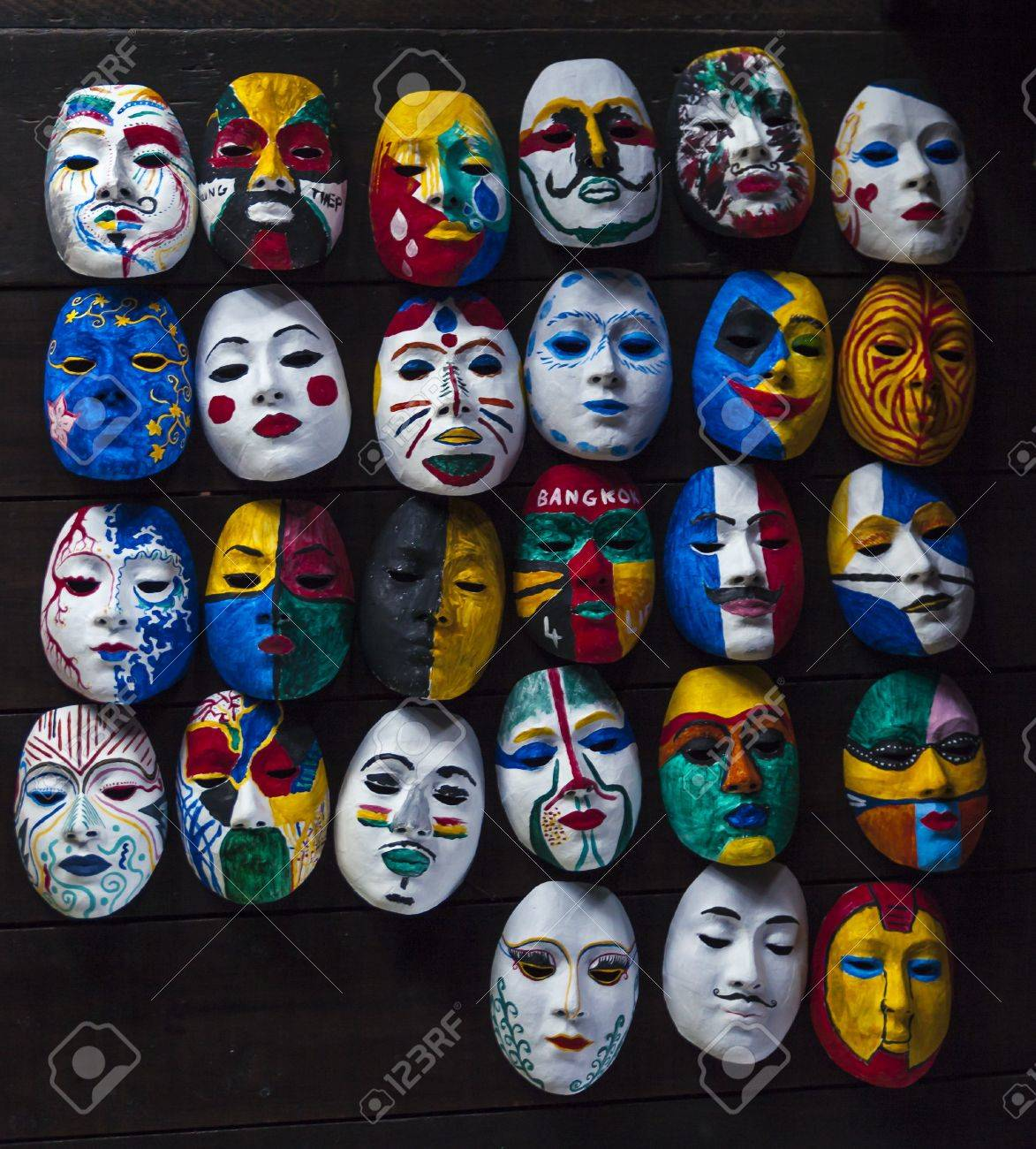 Various Style Mask Painting On Wooden Background Stock Photo