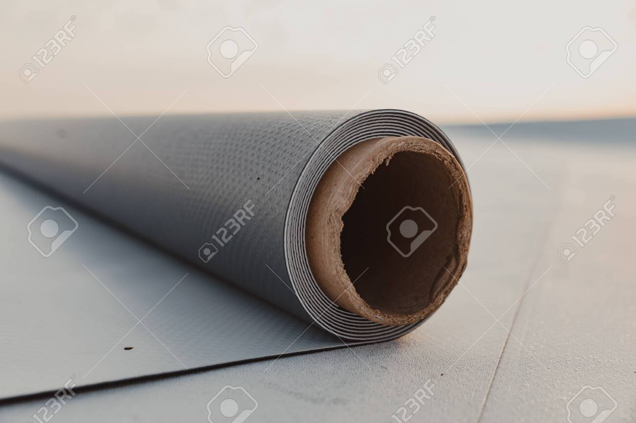 Roofing PVC membrane in rolls placed on the roof of the site - 155260860