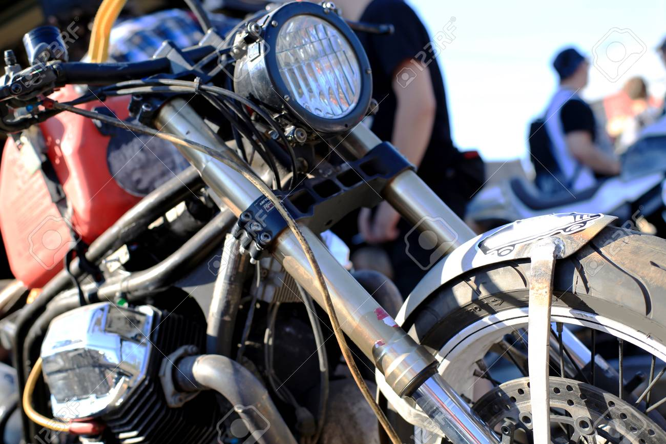 Old Vintage Motorcycle With Chrome Accents And A Headlamp Stock
