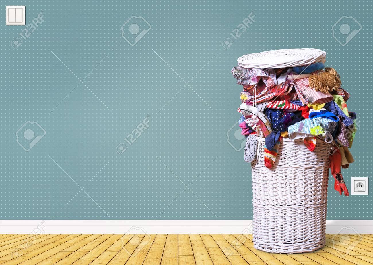 White straw basket full of dirty Laundry - 60673551
