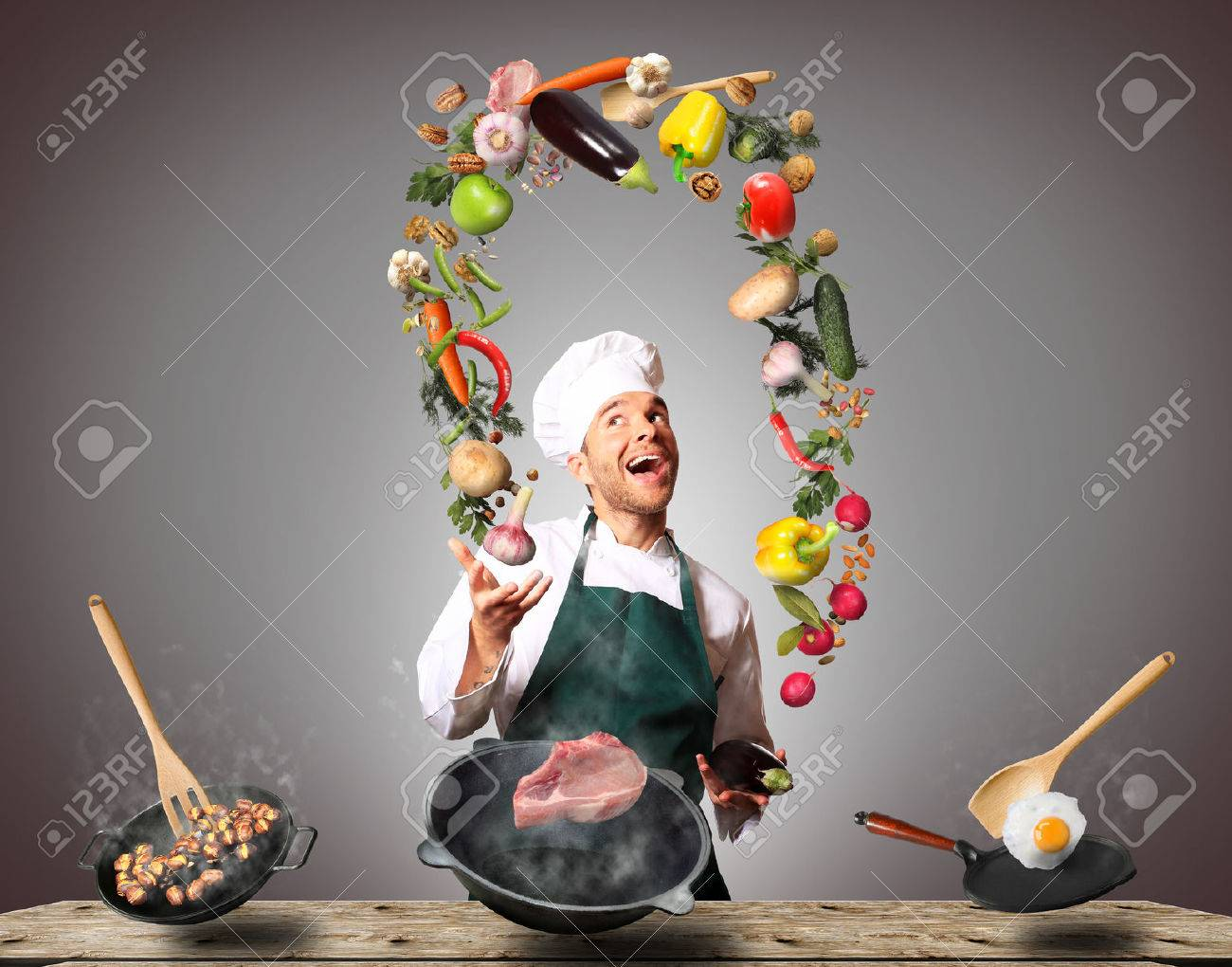 Chef juggling with vegetables and other food in the kitchen - 64915257