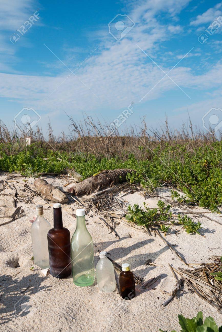 Bottles on Beach Stock Photo - 18445430