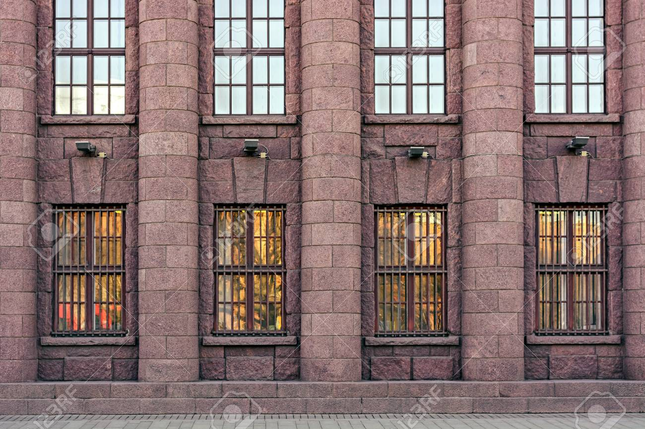 city building windows. Stock Photo  The Facade Of A Building Pink Granite With Windows And Columns In The City Saint Petersburg From Series Window Facade Of A Building Pink Granite With Windows And Columns