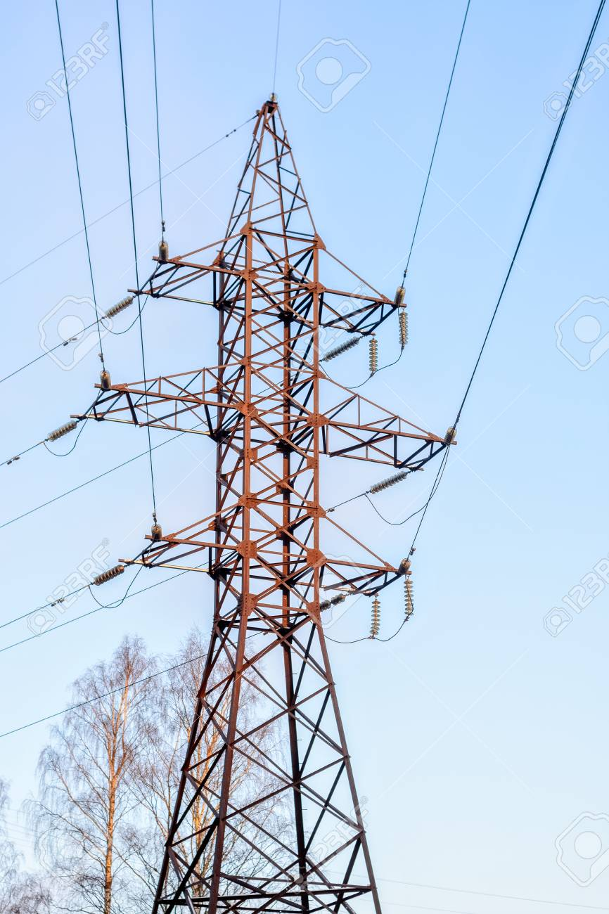 Steel Support Of The Line Of High-voltage Wires Against The Blue ...