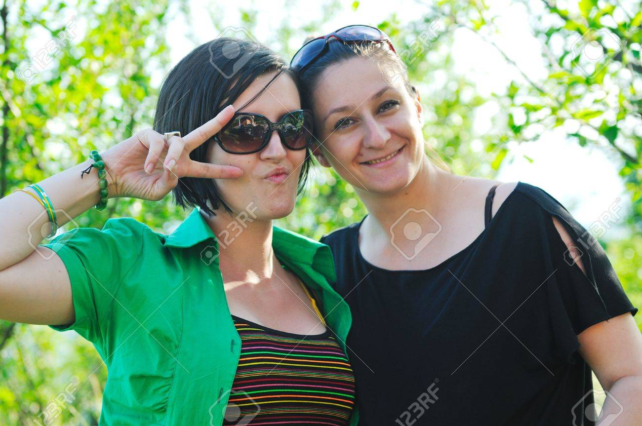 woman pragnant outdoor with friend smile and joy Stock Photo - 5293401