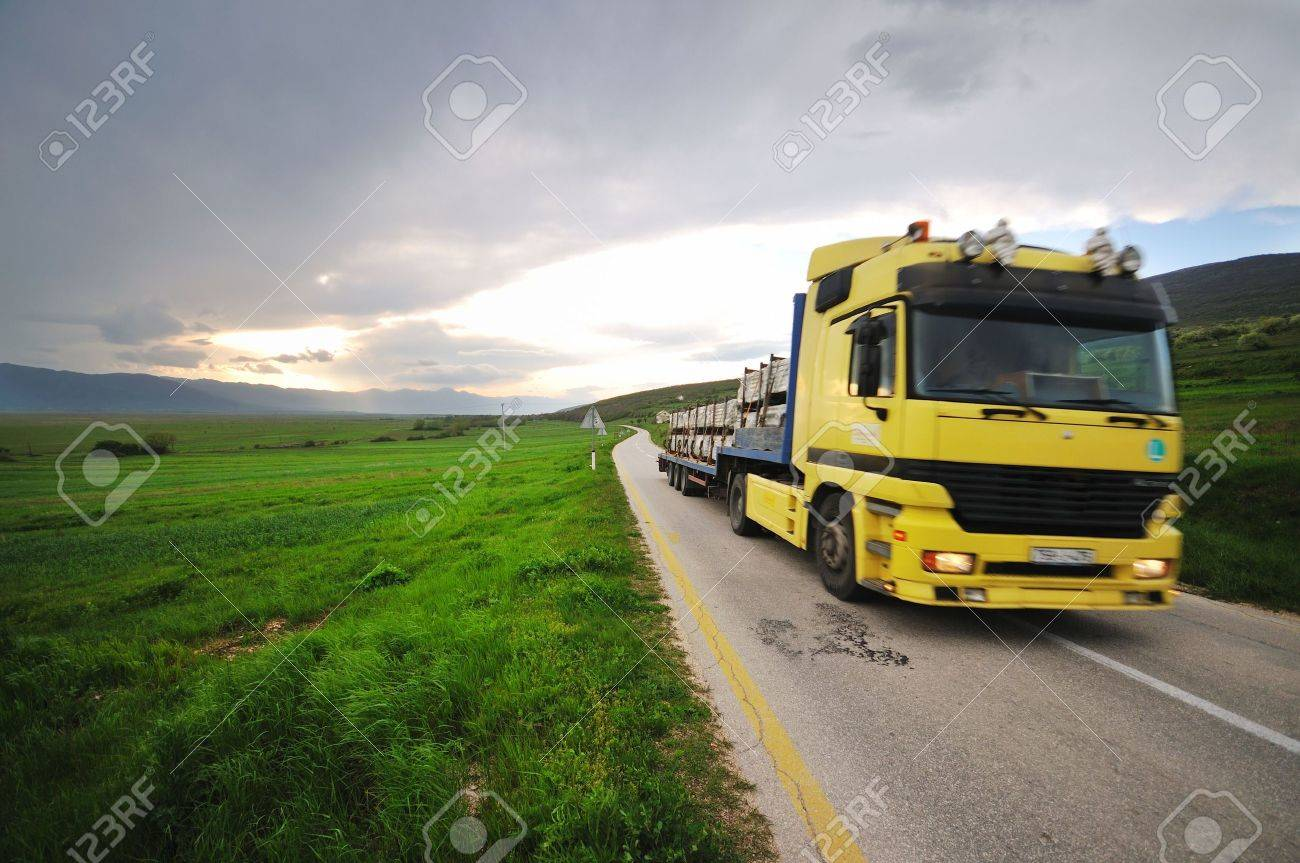 big truck drive on long country road Stock Photo - 5267489