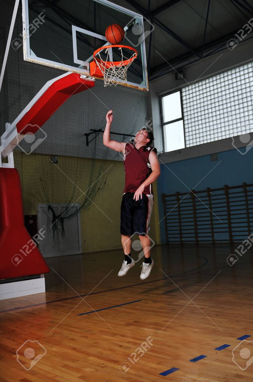 one healthy young  man play basketball game in school gym indoor Stock Photo - 5272510