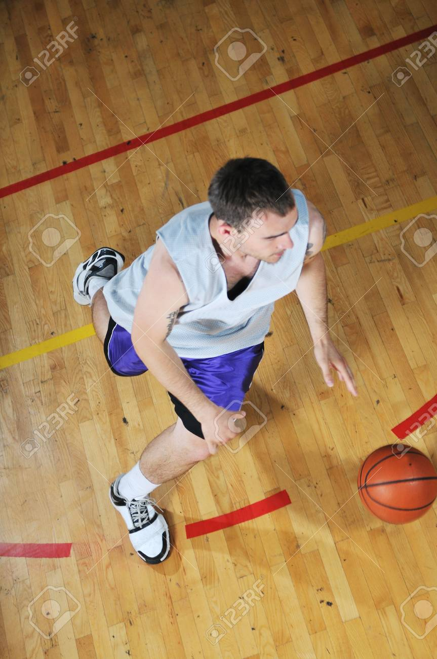 one healthy young  man play basketball game in school gym indoor Stock Photo - 5298214