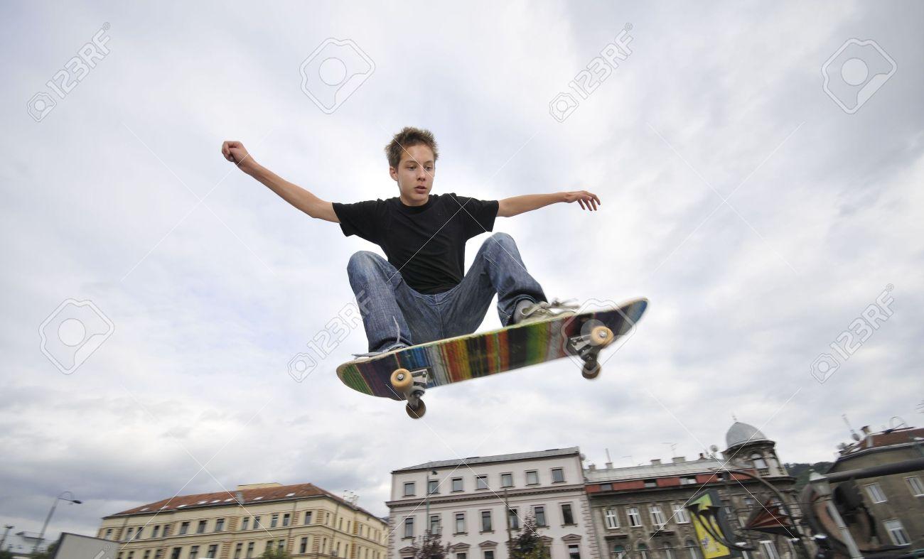 Boy practicing skate in a skate park Stock Photo - 5328982