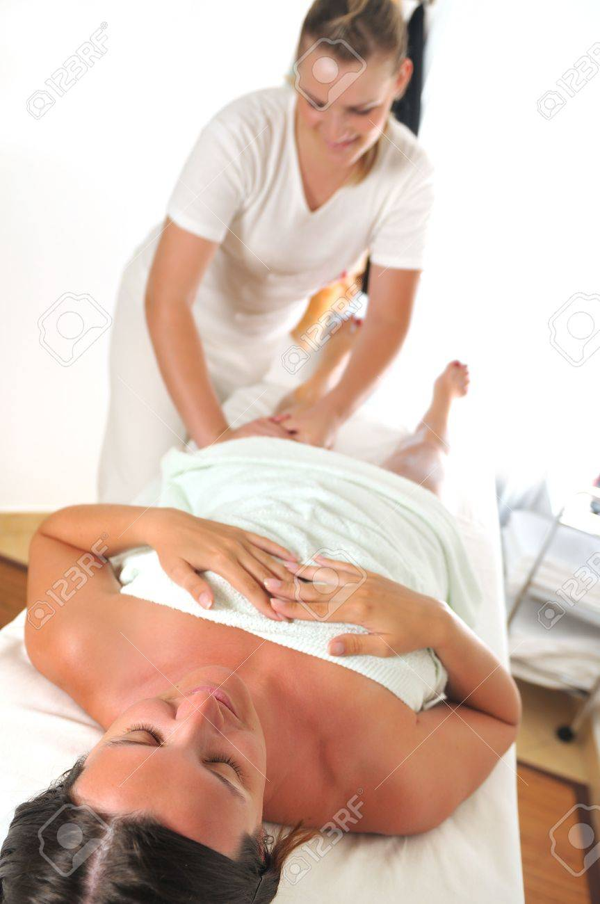 beautiful woman having leg and foot massage at the spa and wellness center Stock Photo - 5298713
