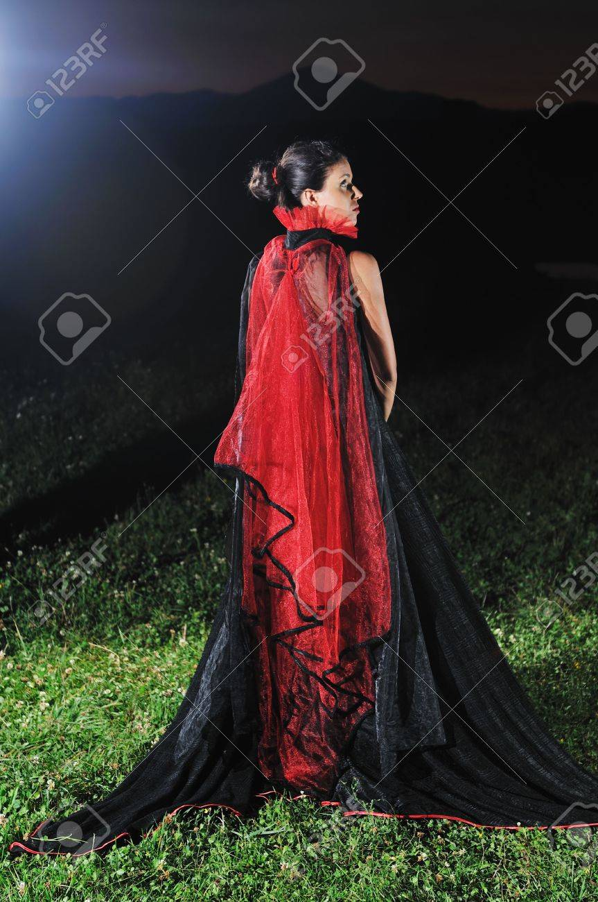 young beautiful bride in black wedding dress in dar at night Stock Photo - 5421267