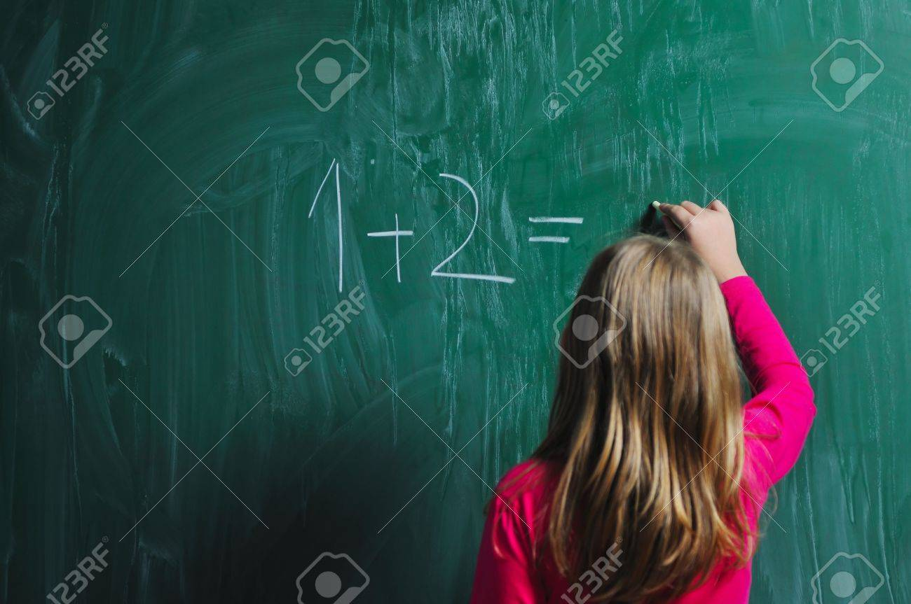 happy school girl on math classes finding solution and solving problems Stock Photo - 6118362