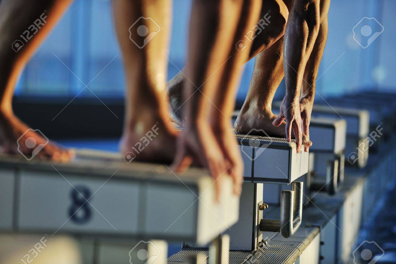 start position race concept with fit swimmer on swimming pool Stock Photo - 5982100