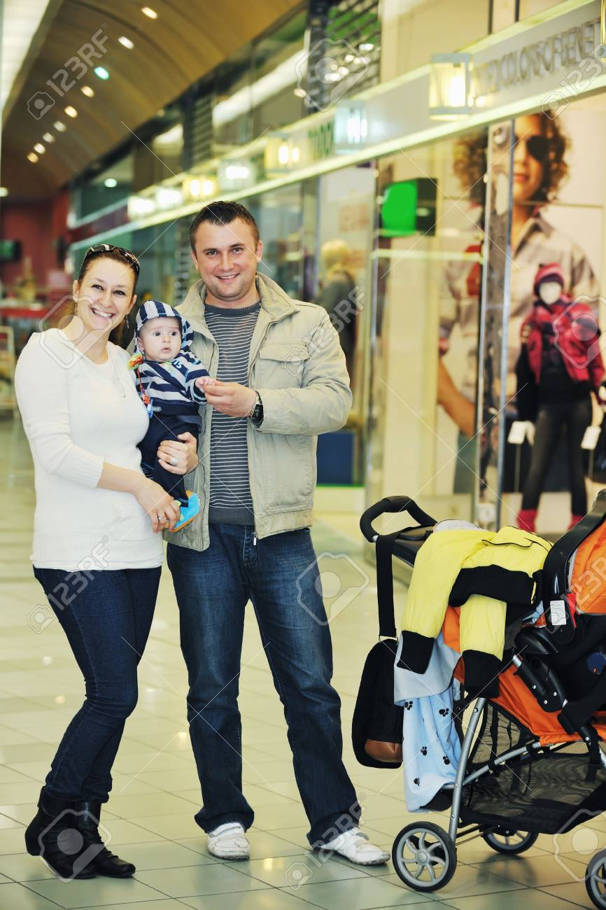 happy young family in shopping centre indoor Stock Photo - 6028617