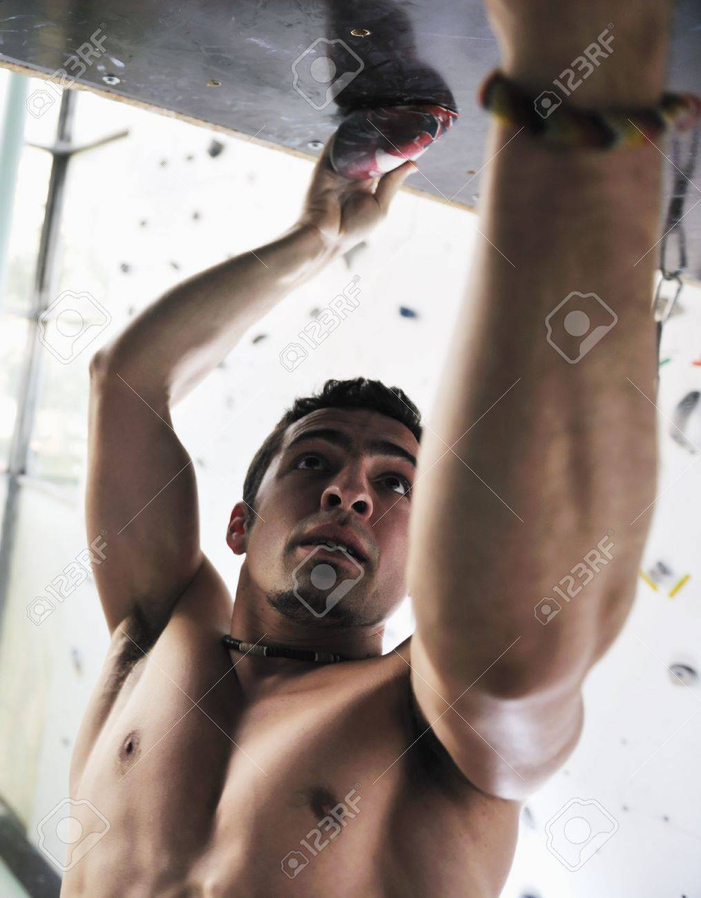 young and fit man exercise free mountain climbing on indoor practice wall Stock Photo - 6321877
