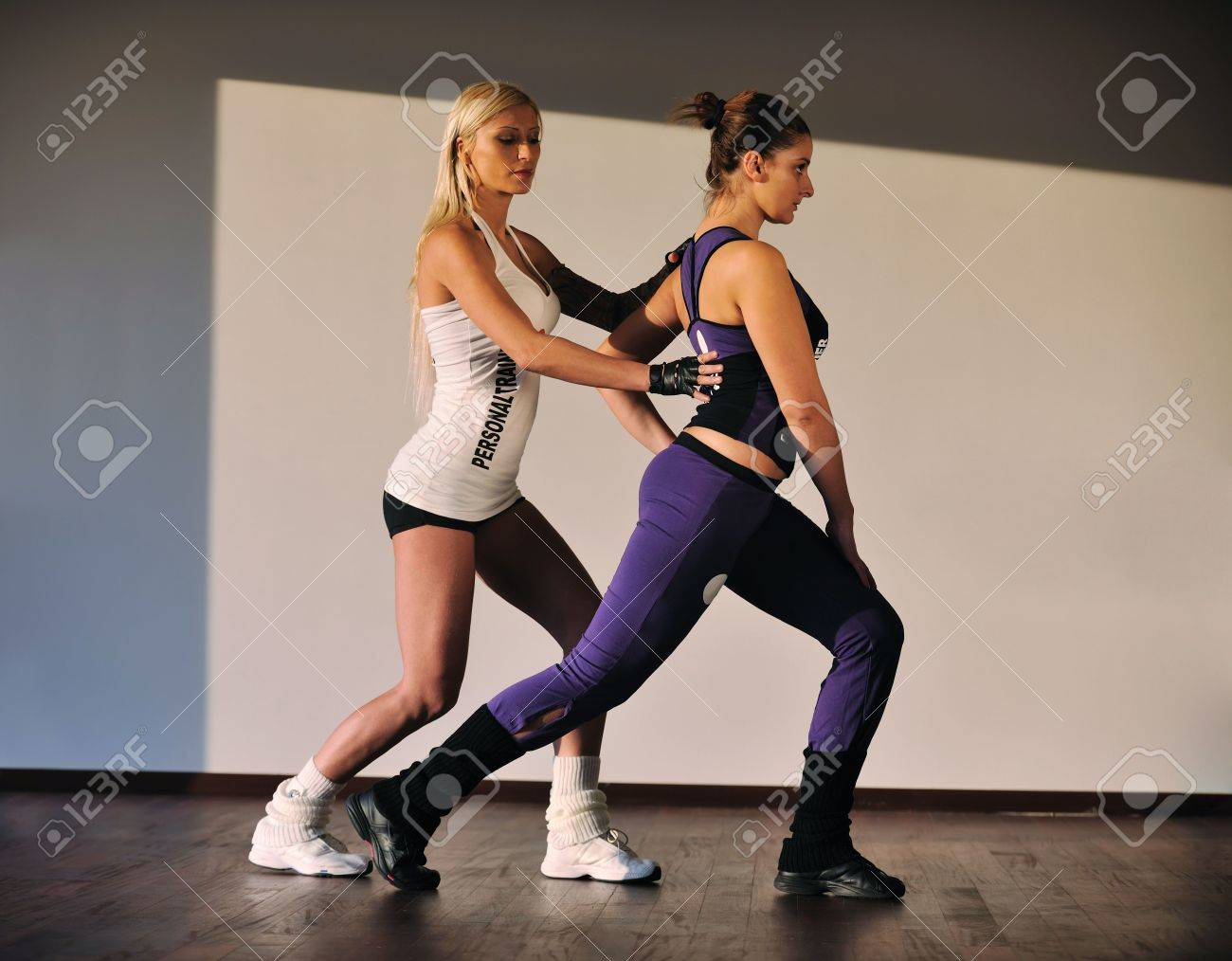 fitness woman personal trainer in sport club indoor Stock Photo - 6403390