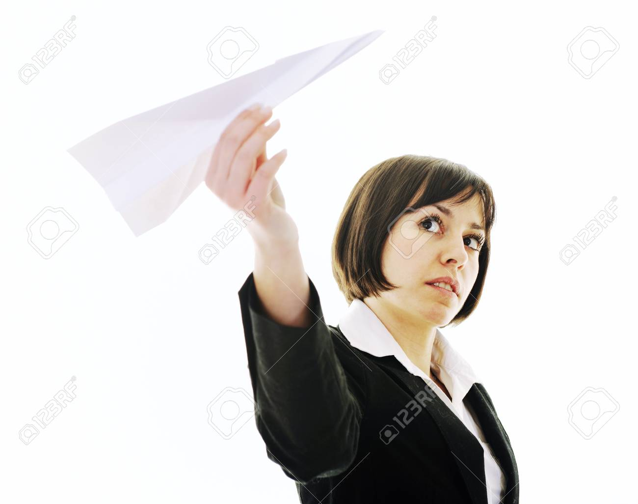 happy young business woman isolated ona white throwing paper airplane Stock Photo - 6517093
