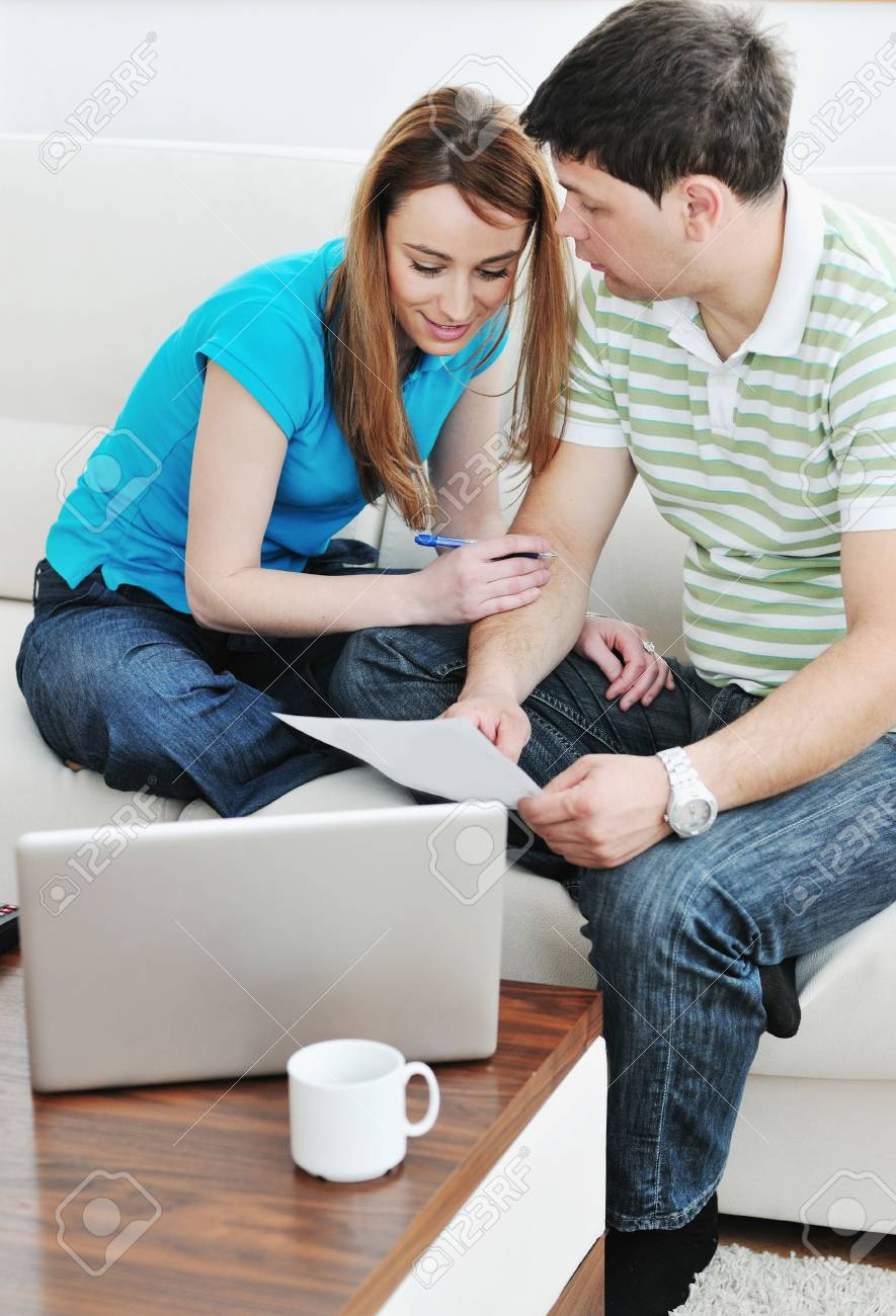 young couple at home with  modern livingroom indoor working on laptop on house finance and planing Stock Photo - 6742339