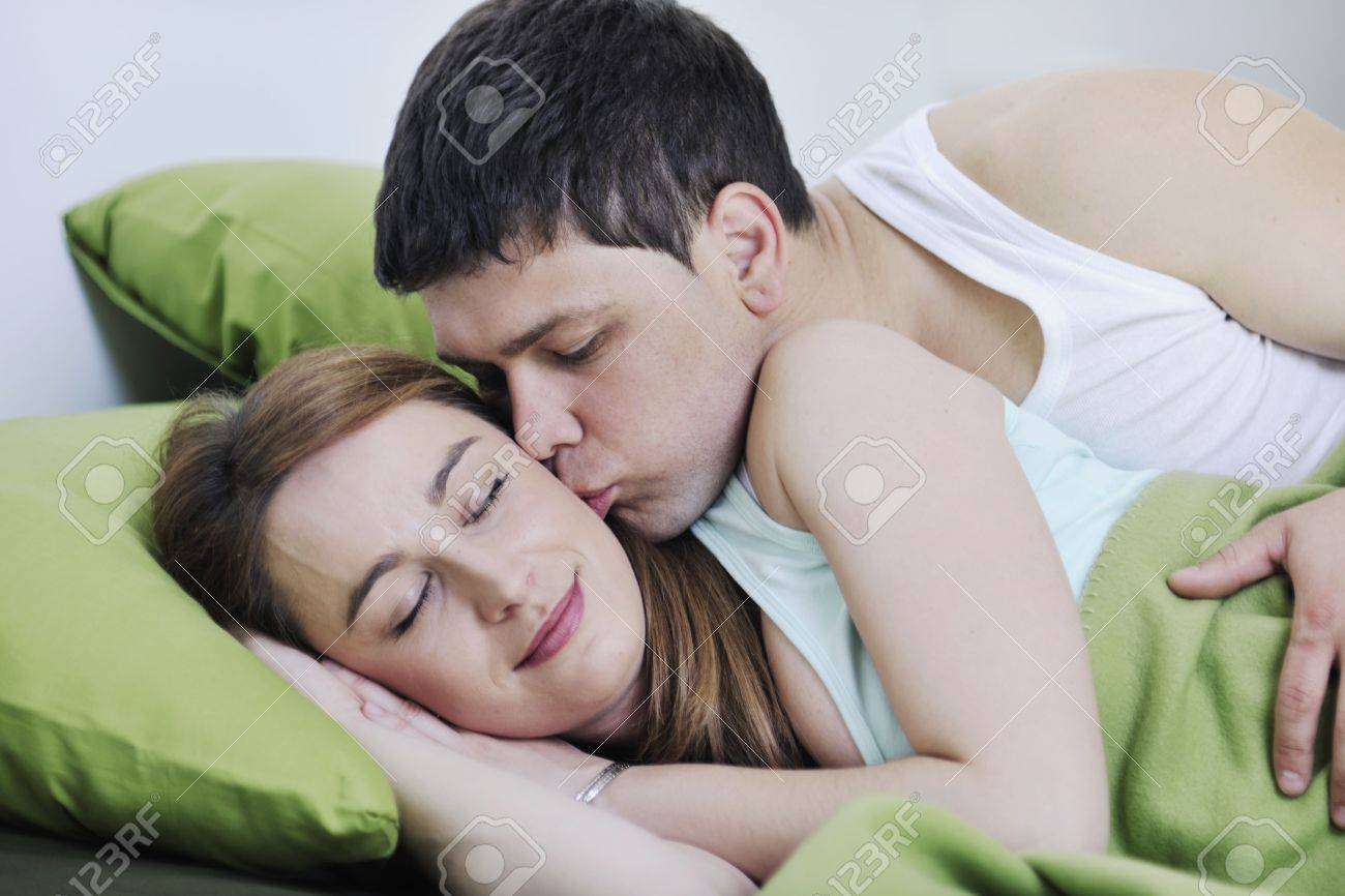 happy young couple in bed at morning Stock Photo - 6742409