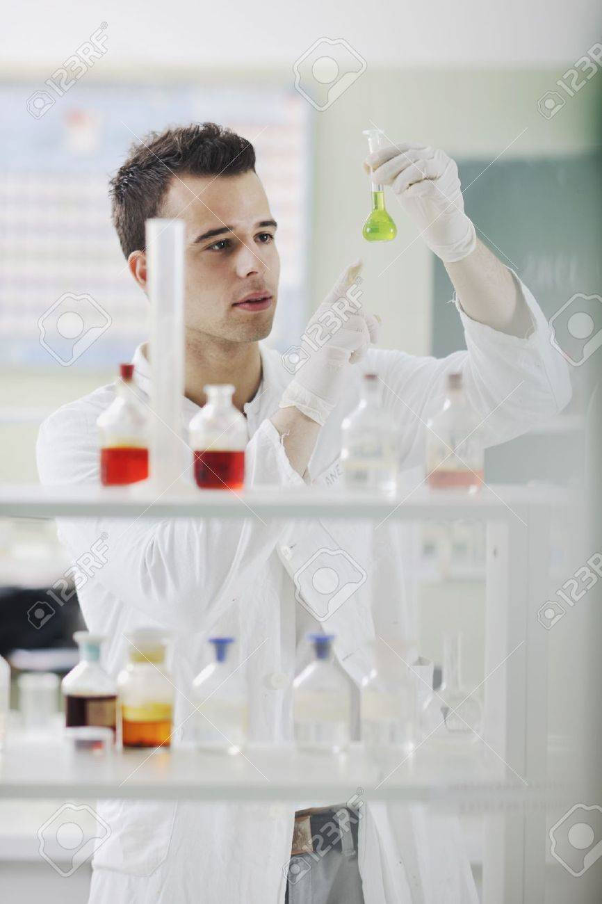 young man scientist in chemistry bright lab Stock Photo - 6846469