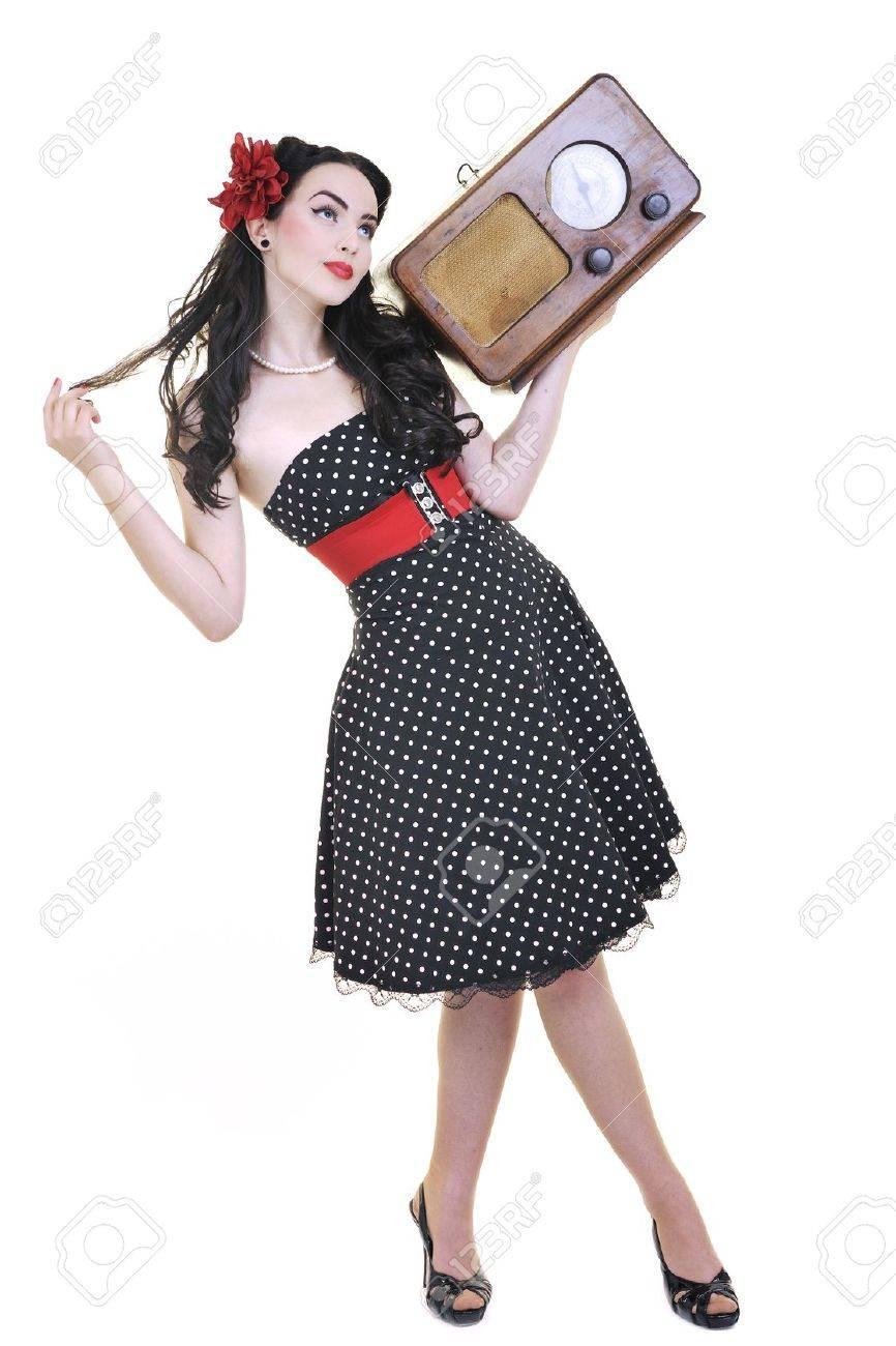 pretty girl listening music on radio isolated on white in studio Stock Photo - 7147590