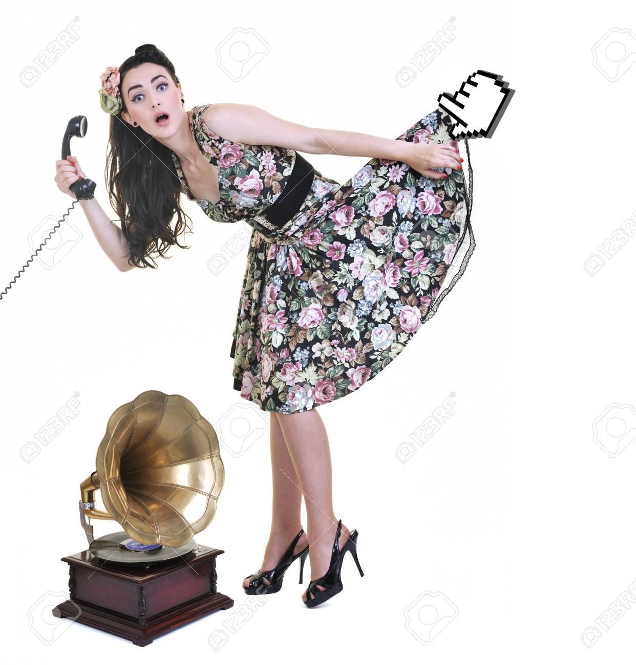 pretty young woman talking by old phone and mouse cursor arrow is holding her skirt Stock Photo - 7161611