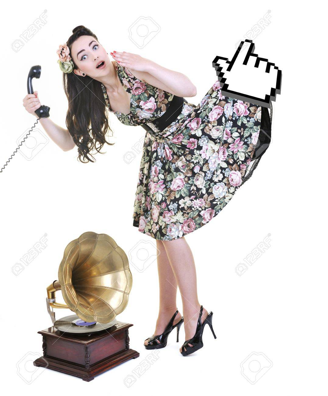 pretty young woman talking by old phone and mouse cursor arrow is holding her skirt Stock Photo - 7161594