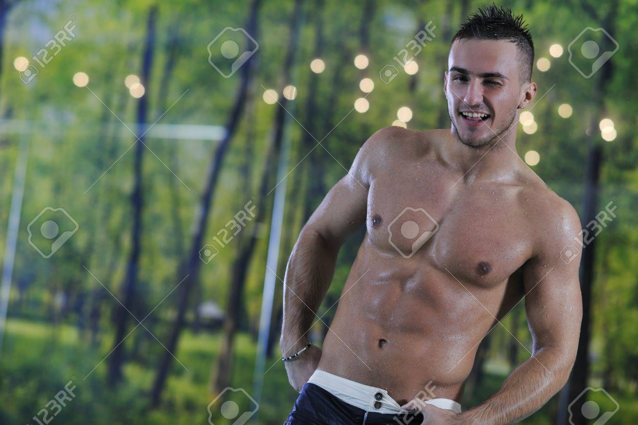 young healthy good looking macho man model athlete at hotel indoor pool Stock Photo - 7329067