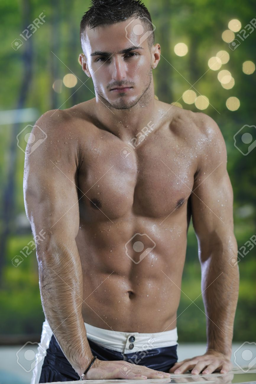 young healthy good looking macho man model athlete at hotel indoor pool Stock Photo - 7286128