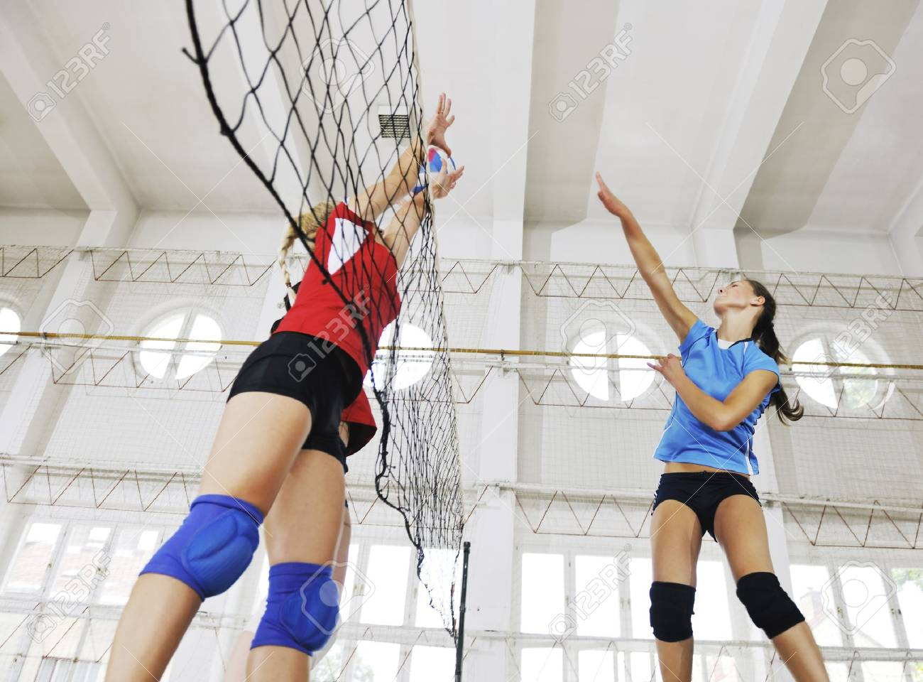 volleyball game sport with group of young beautiful  girls indoor in sport arena Stock Photo - 7822502