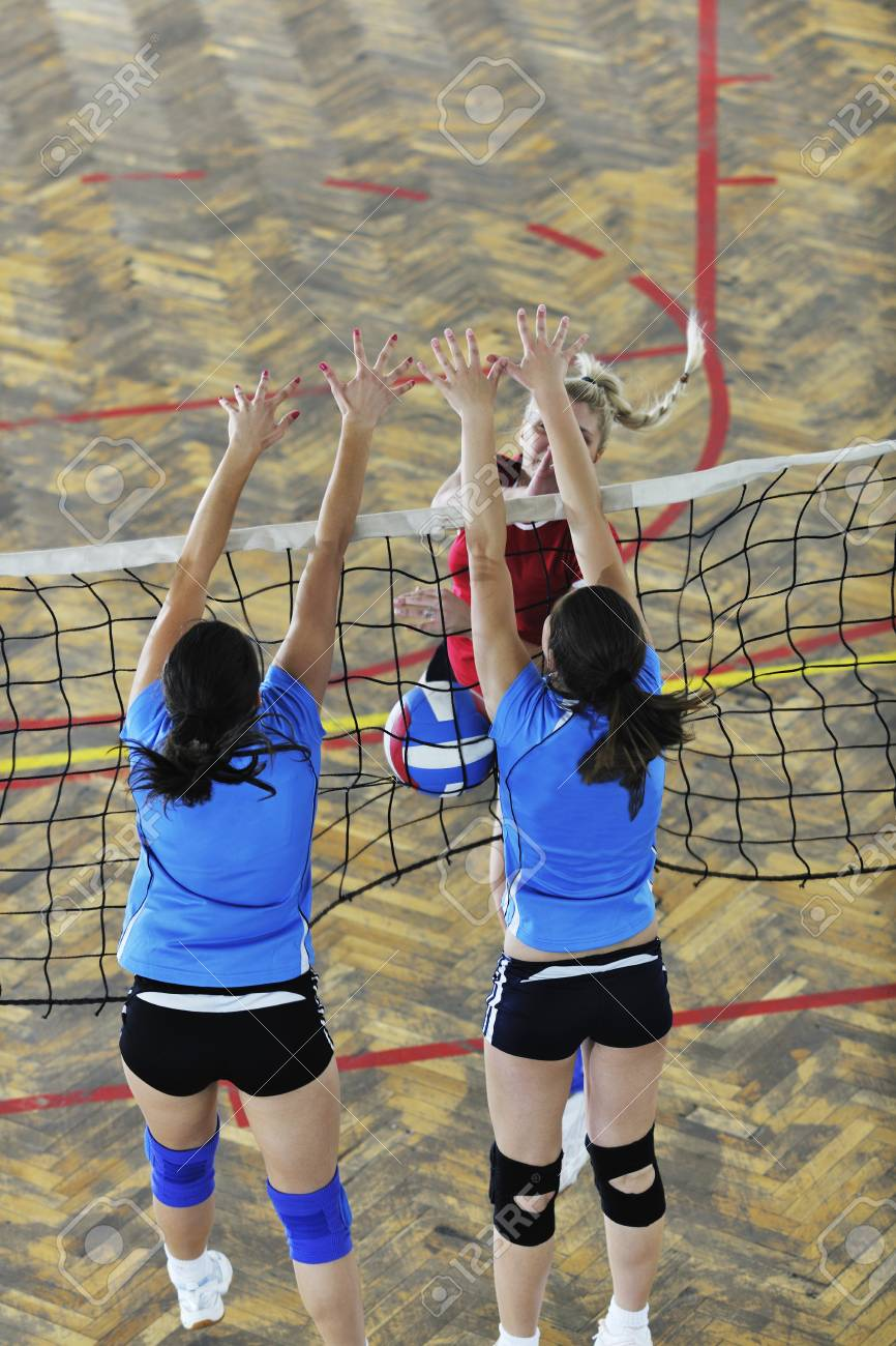 volleyball game sport with group of young beautiful  girls indoor in sport arena Stock Photo - 7682543