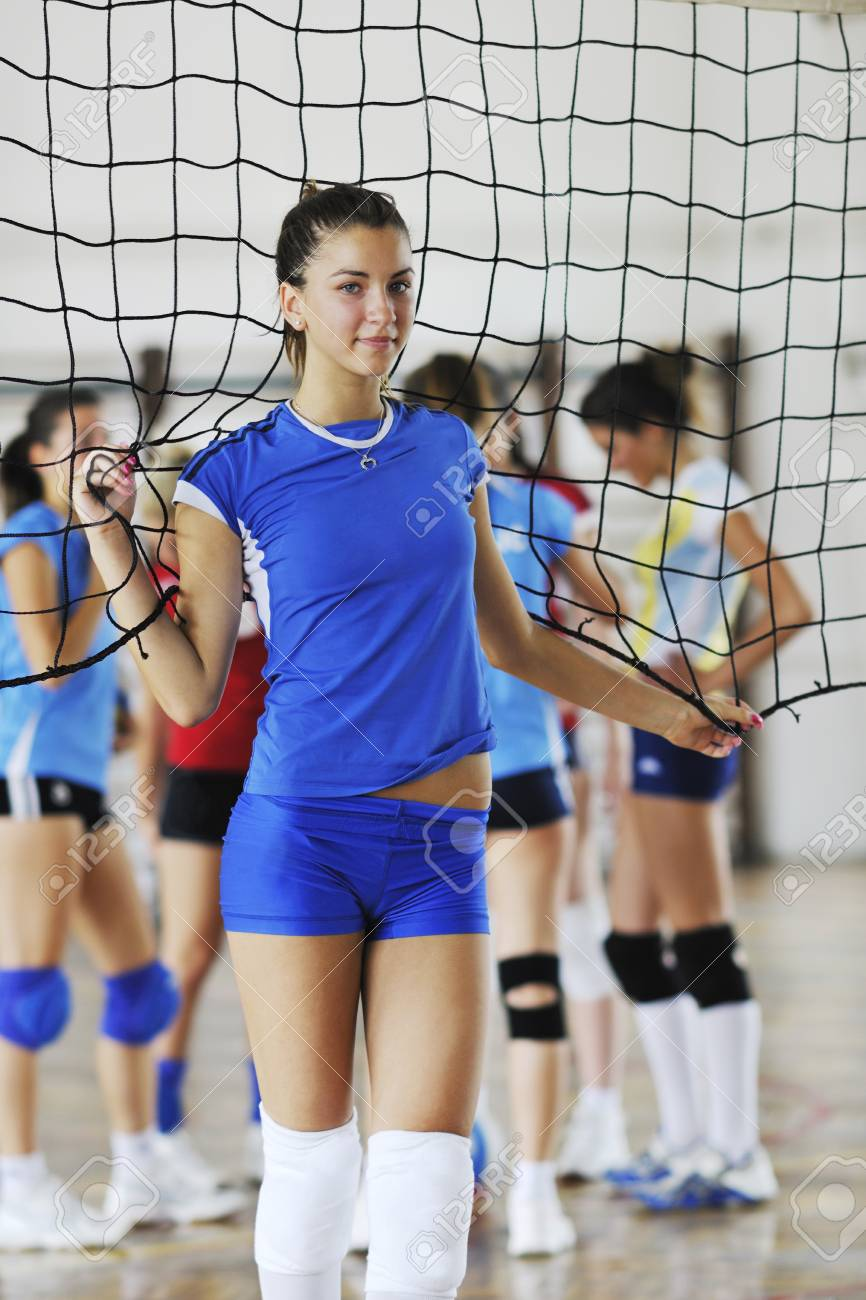 volleyball game sport with group of young beautiful  girls indoor in sport arena Stock Photo - 7821055