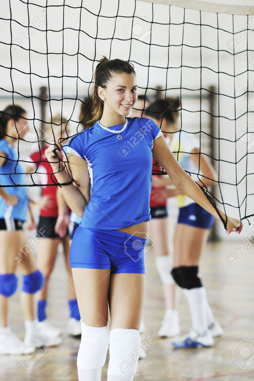 volleyball game sport with group of young beautiful  girls indoor in sport arena Stock Photo - 7815445