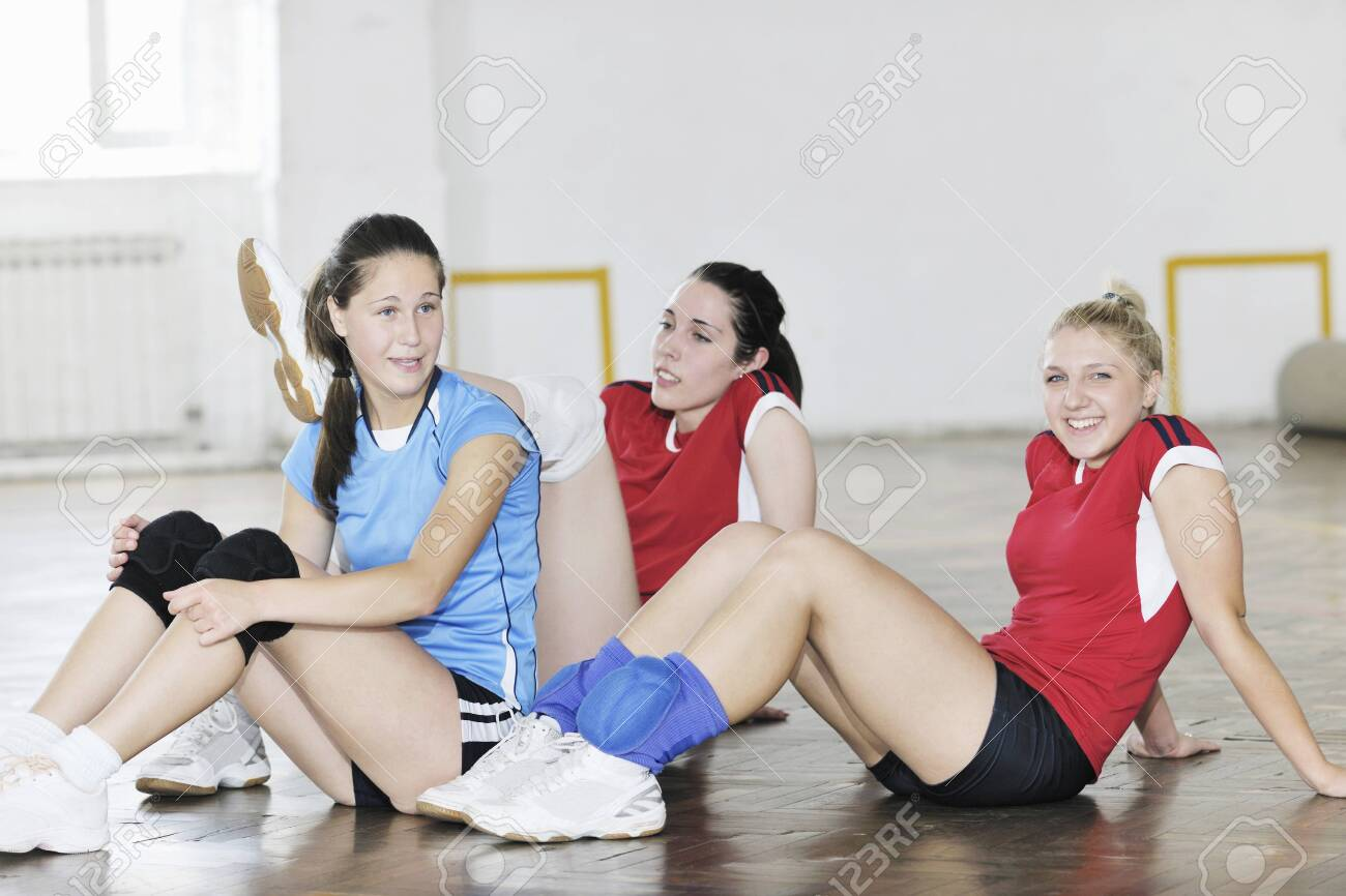 volleyball game sport with group of young beautiful  girls indoor in sport arena Stock Photo - 7850970