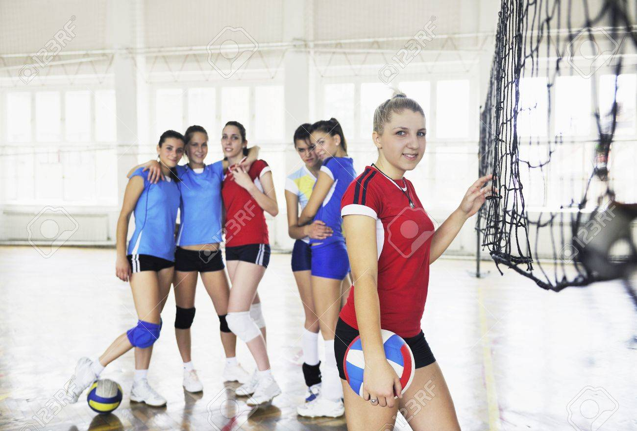 volleyball game sport with group of young beautiful  girls indoor in sport arena Stock Photo - 7829525