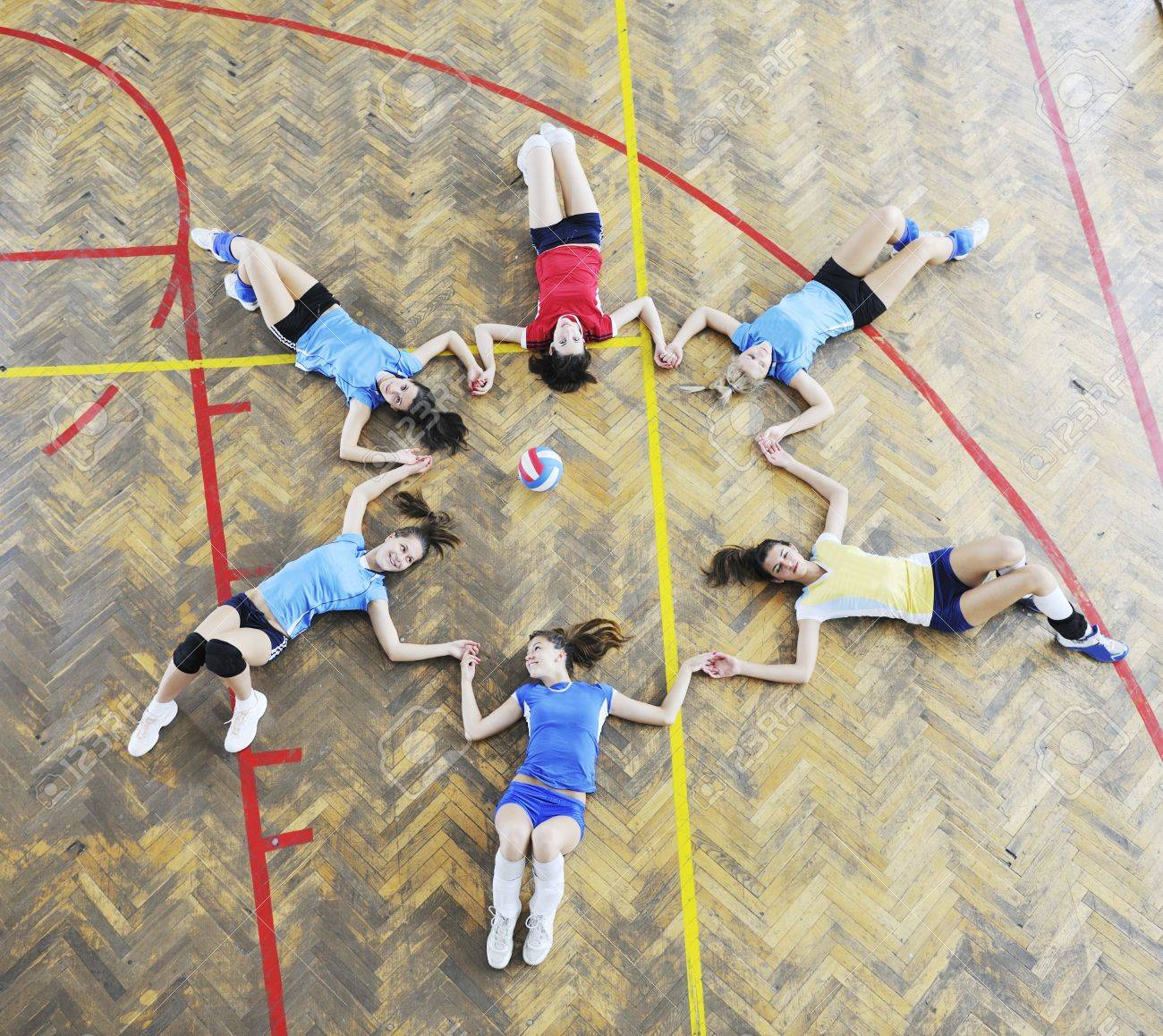 volleyball game sport with group of young beautiful  girls indoor in sport arena Stock Photo - 7814905