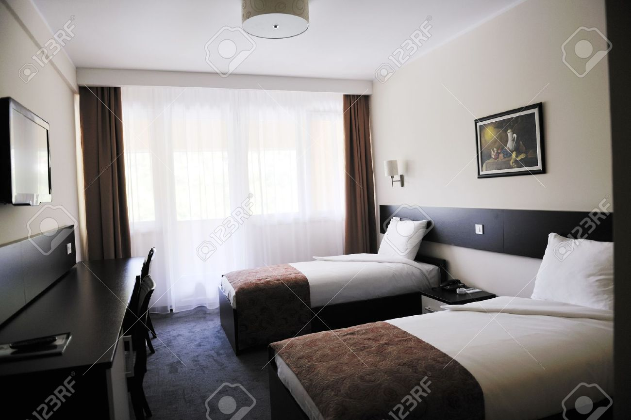 Hotel Room Interior bright and clean hotel room interior with modern furniture stock